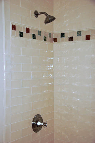 handmade tile border in a bathroom shower