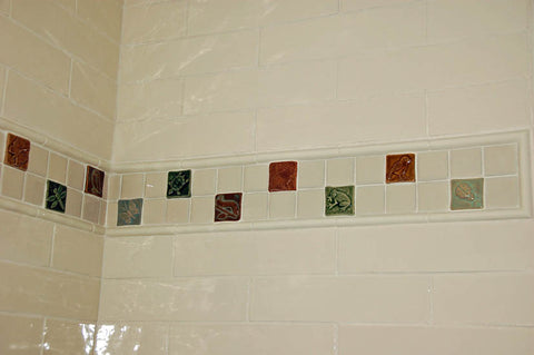 handmade animal tile border for a children's bathroom