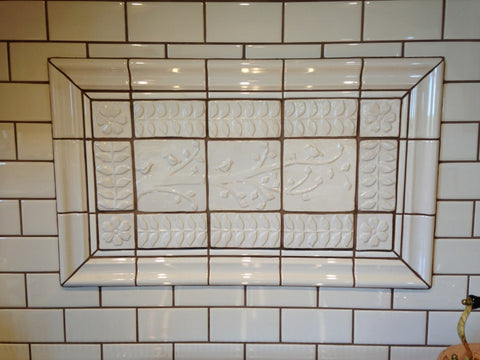 handmade tiles installed in kitchen, white glaze