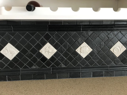 black and white back splash with handmade tiles and slate