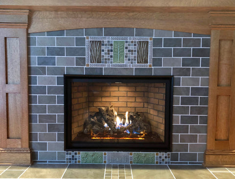 handmade tiles installed in a fireplace surround