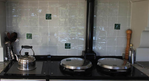 handmade tiles in a kitchen back splash with a mayfly motif
