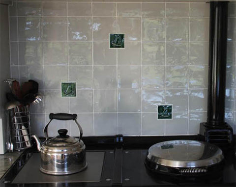 handmade mayfly tiles over a range in a kitchen