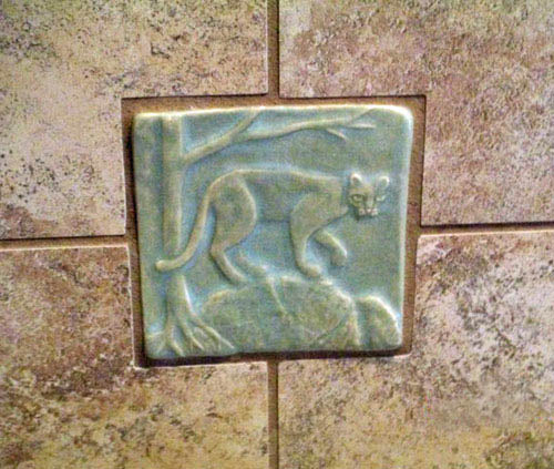 handmade mountain lion or cougar tile installed in shower