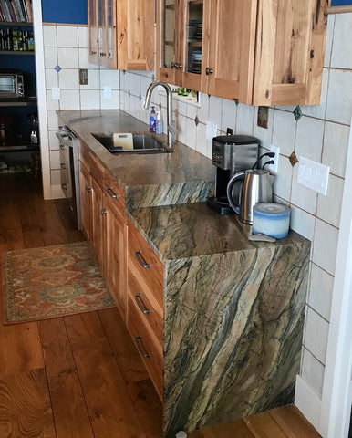 handmade tiles in a kitchen with waterfall stone counter top