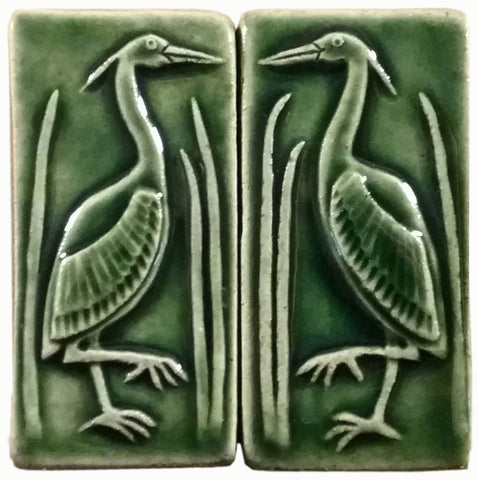 pair of herons two inch by four inch handmade tile set