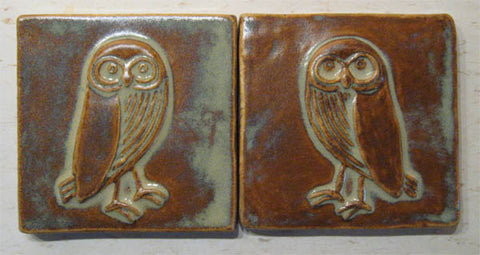 a pair of handmade owl tiles