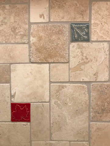 multicolored small handmade tiles in a kitchen backsplash