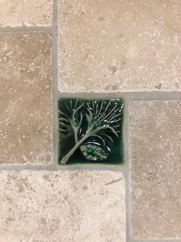 close up of a handmade pine tile installed in a kitchen backsplash