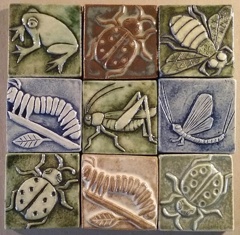 handmade tiles featuring insects and animals for the river light gallery in peninsula ohio