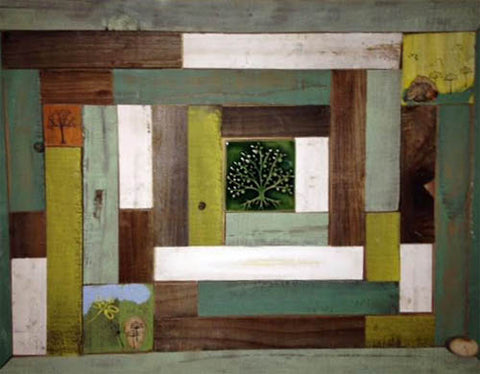 close up of handmade tile framed in reclaimed wood