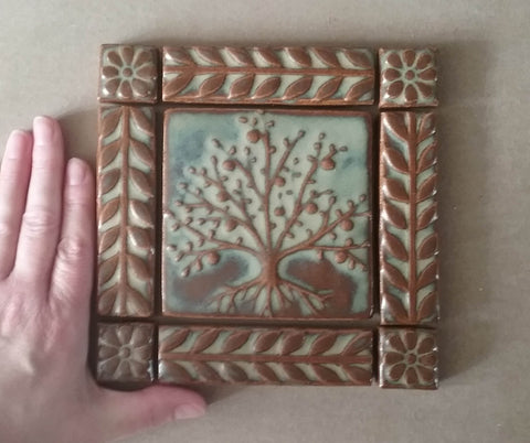 handmade tile set featuring a tree of life with a border