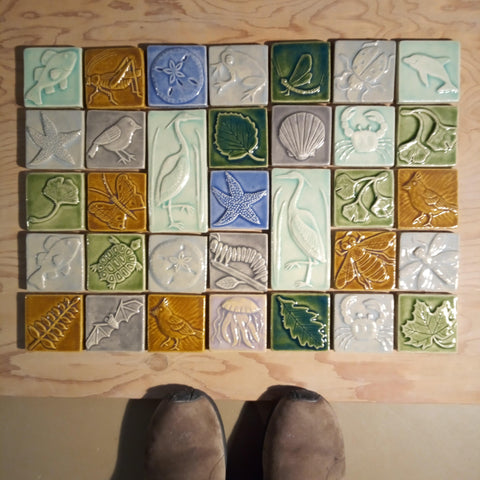 handmade tiles featuring plants and animals