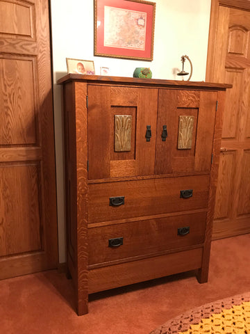 a piece of craftsman style furniture with a dark wood finish featuring handmade tile