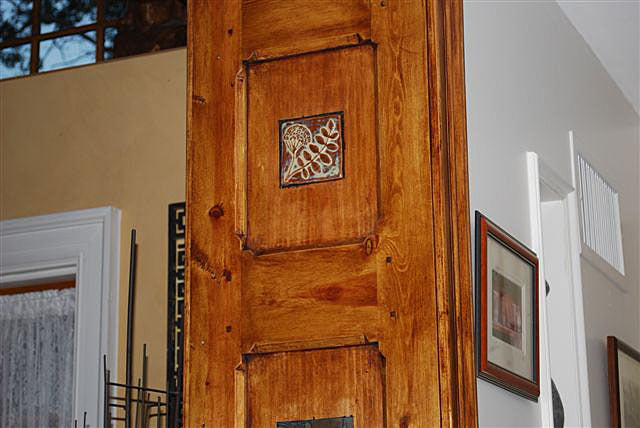 wooden door frame with handmade art tiles, wildflower design