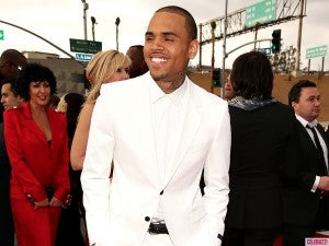 Chris Brown looking sleek in an all-white ensemble.
