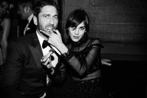 Gerard Butler's black tux seems to be effective with the ladies (and whip cream).