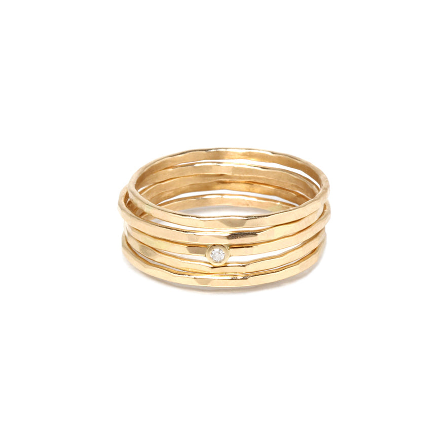 Five Gold Thin Hammered Stacking Rings with Single Diamond