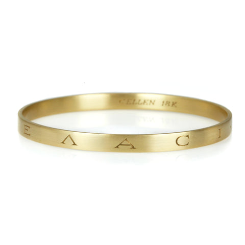 Caroline Ellen 18 Karat Yellow Gold Wide Flat-Edge Bangle with Ancient Greek Engraving.