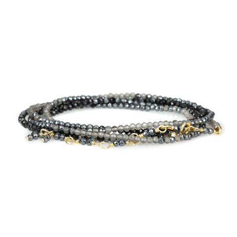 Anne Sportun Ombre Beaded Black Spinel, Hematite, and Slate Moonstone Wrap Bracelet with 18 Karat Yellow Gold Bead, Clasp, and Tied Tassel Extension.
