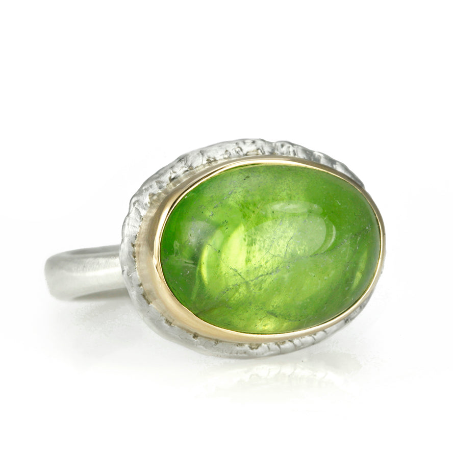 "Oval Smooth Peridot Ring with ""Lava"" Platform"
