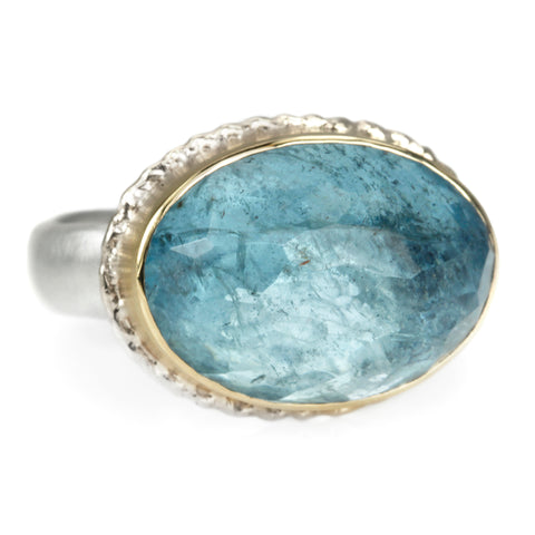 Oval Faceted Aquamarine Ring in Ruffled Gold Bezel