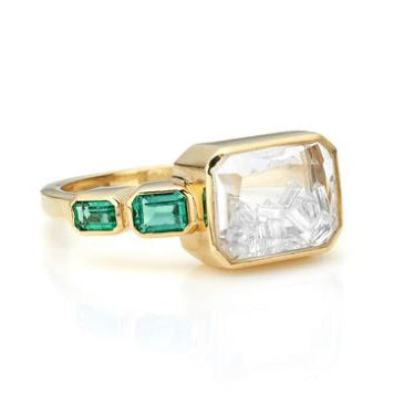 "Gold Ring with Diamond ""Shake"" and Emerald Baguette Details"