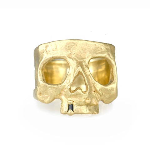 "Gold ""Snaggletooth"" Skull Ring with Single Black Sapphire"