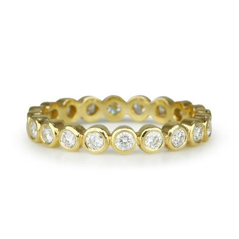 18 Karat Yellow Gold Eternity Ring with Bezel-Set Diamonds (0.66 tcw). Size 6.5.