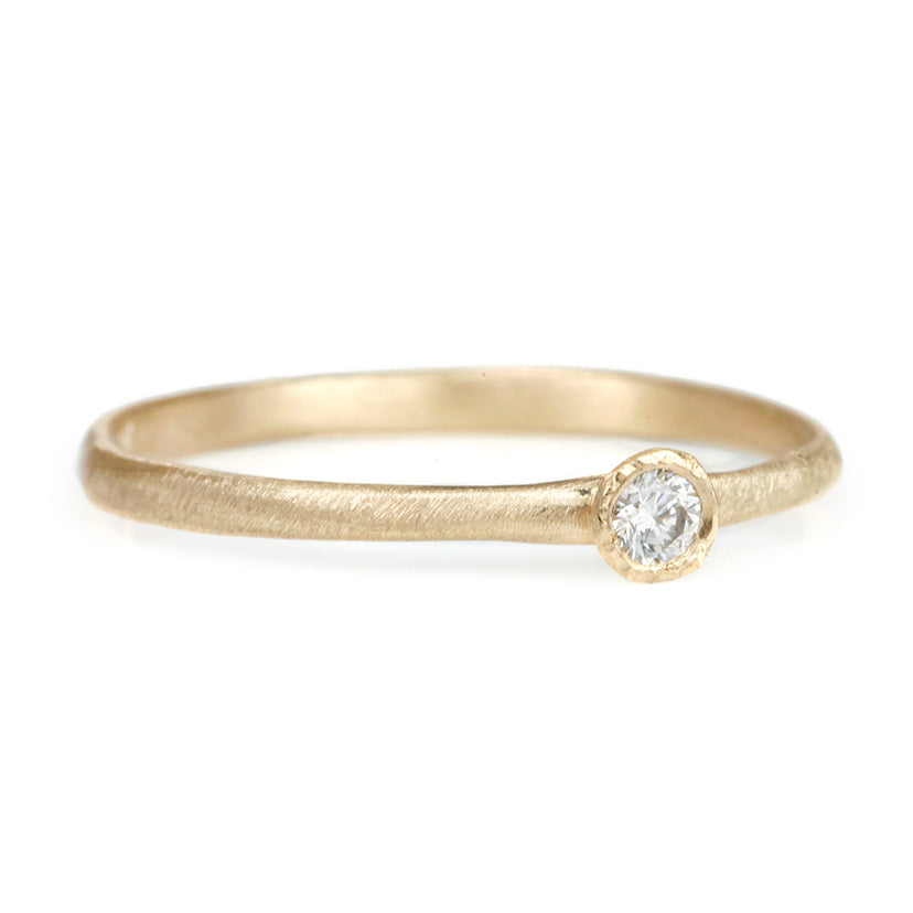 Gold Ring with Single Bezel-Set Diamond