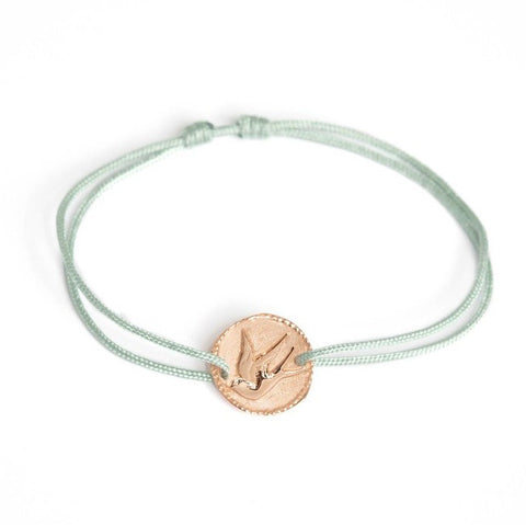 "Tiny Om Rose Gold ""Graceful Songbird"" Disc Bracelet on Green Cord"