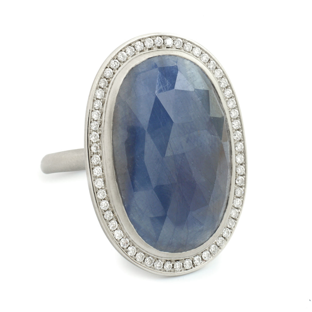 White Gold and Oval Blue Sapphire Ring with Diamond Halo