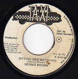 "Dennis Brown Sitting And Watching- VG- 7"" SIngle 45RPM- Taxi Jamaica- Reggae"