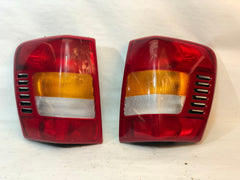 99-04 Grand Cherokee WJ Tail Brake Light Taillight Lamp Pair Set