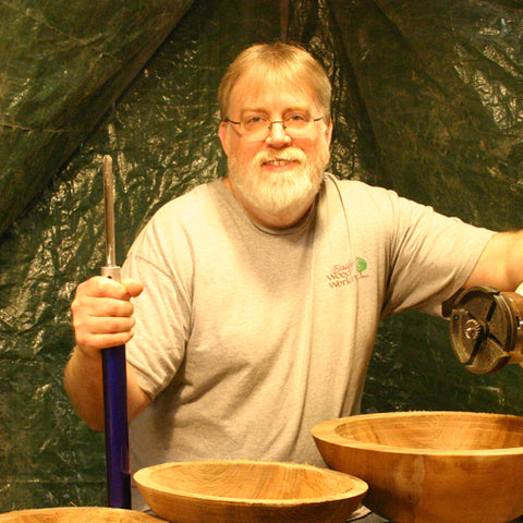 Kim Dailey at the lathe with some roughed out bowls - Dailey Woodworking
