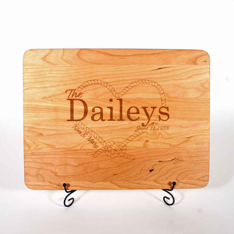 Cherry cutting board custom laser engraved with rope heart and couples names and date of marriage - Dailey Woodworking