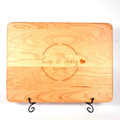 Cherry cutting board laser engraved with couples first names and year of marriage - Dailey Woodworking