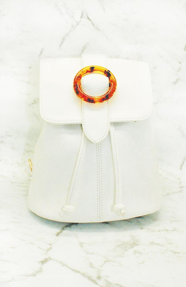 tort circle white vegan leather mini flap backpack