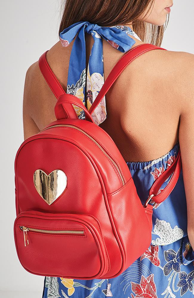 diamond heart applique red vegan leather backpack