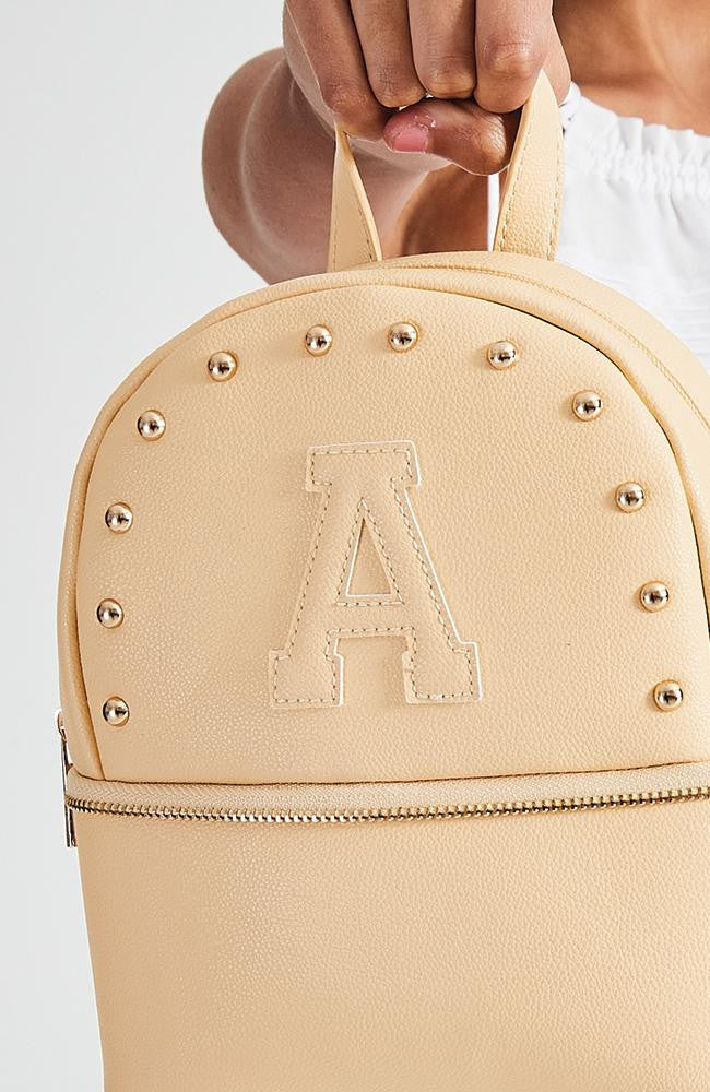a+ pastel yellow studded vegan leather mini backpack