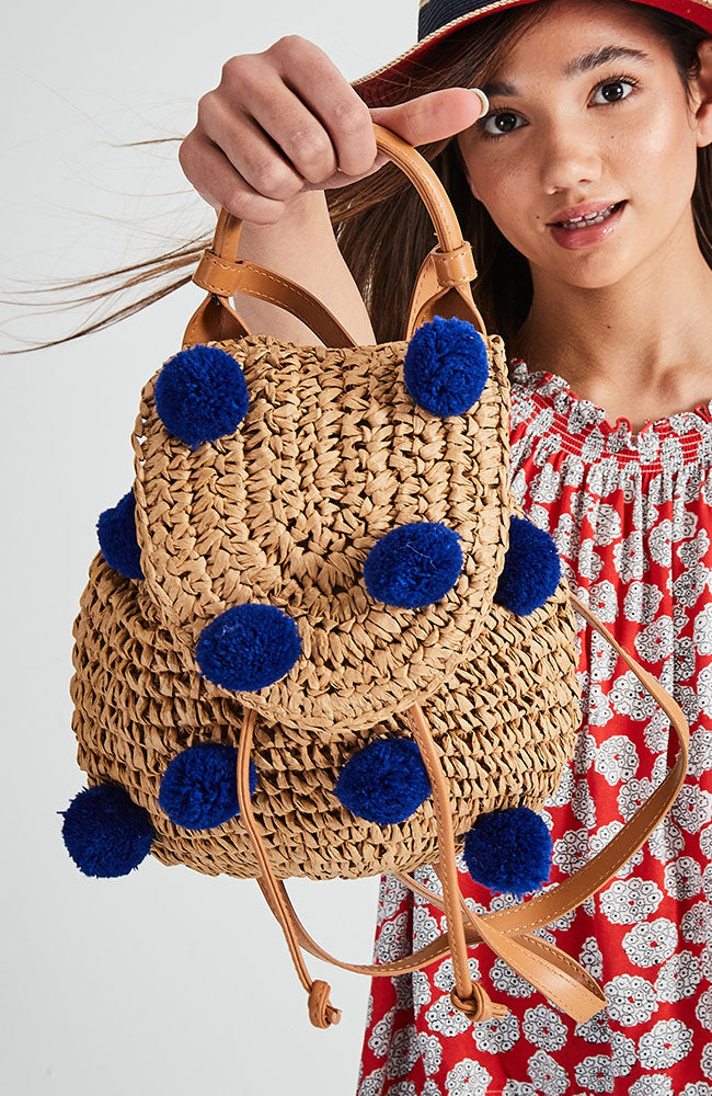 pom pom straw backpack