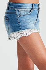 violet mid-rise white lace raw hem denim short