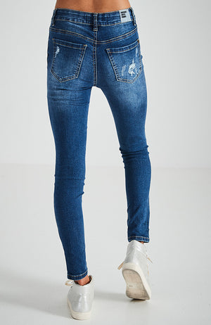 zelda mid blue faded rips stretch denim skinny mid rise jean