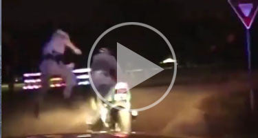OFFICER KICKS MOTORCYCLE OFF BIKE DURING STOP!!!