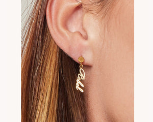 Gold statement dangling earrings uae