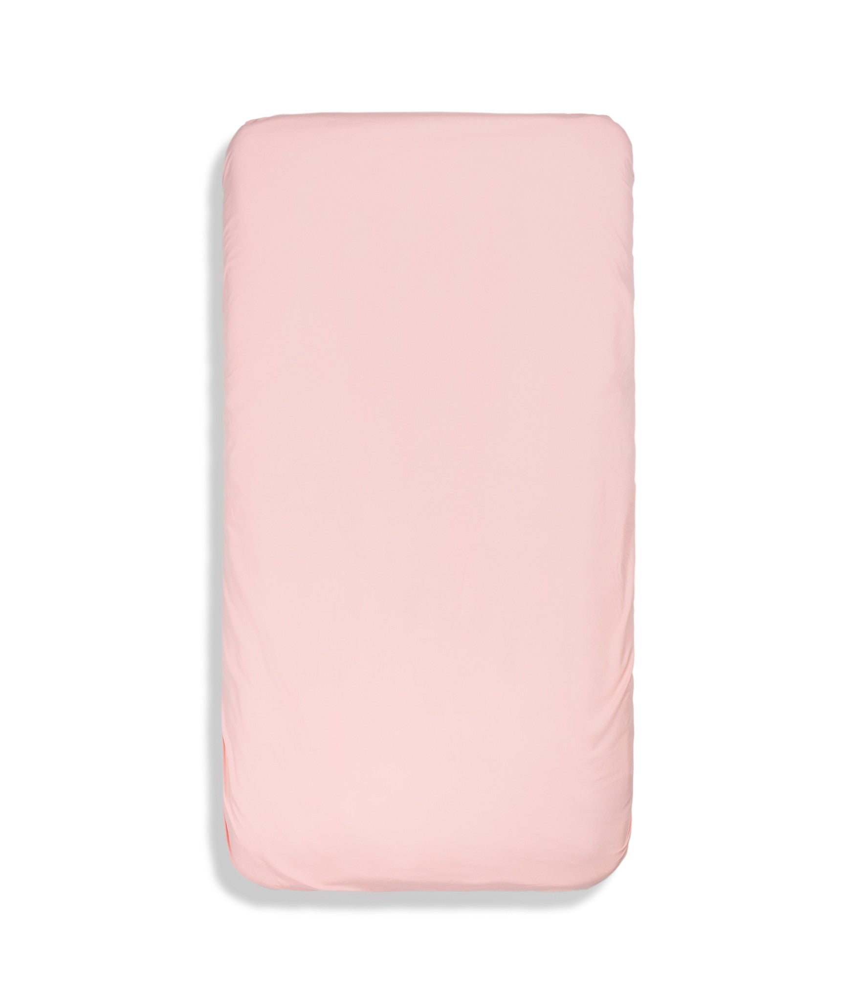 Organic cotton solid colour kids fitted sheet. Fully elasticized. Pink colour.