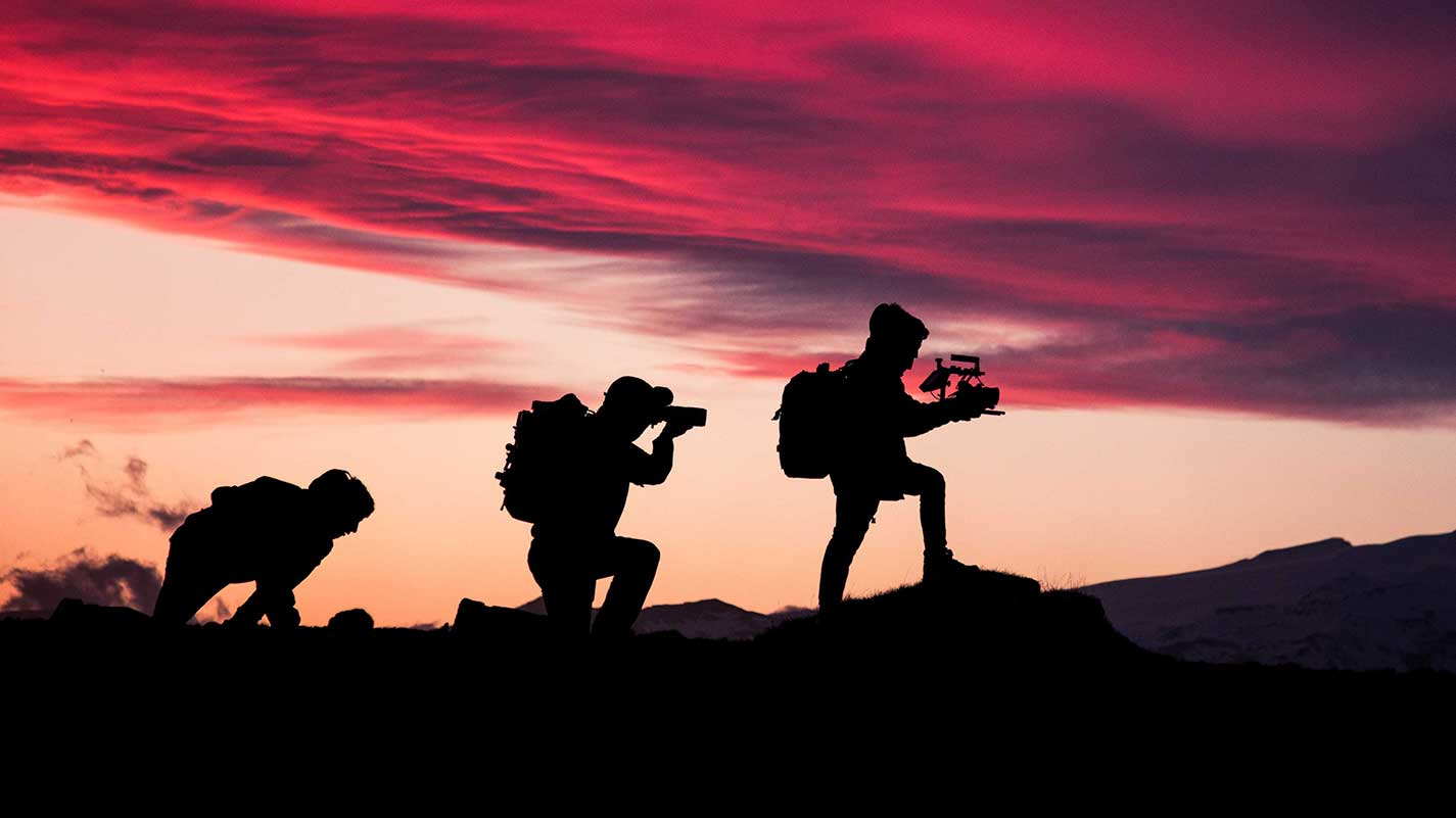 cameramen at sunset