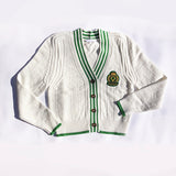 knit cardigan with feminist crest