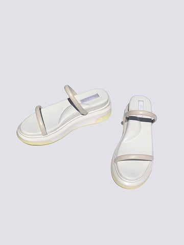 white puffy ergo sandal