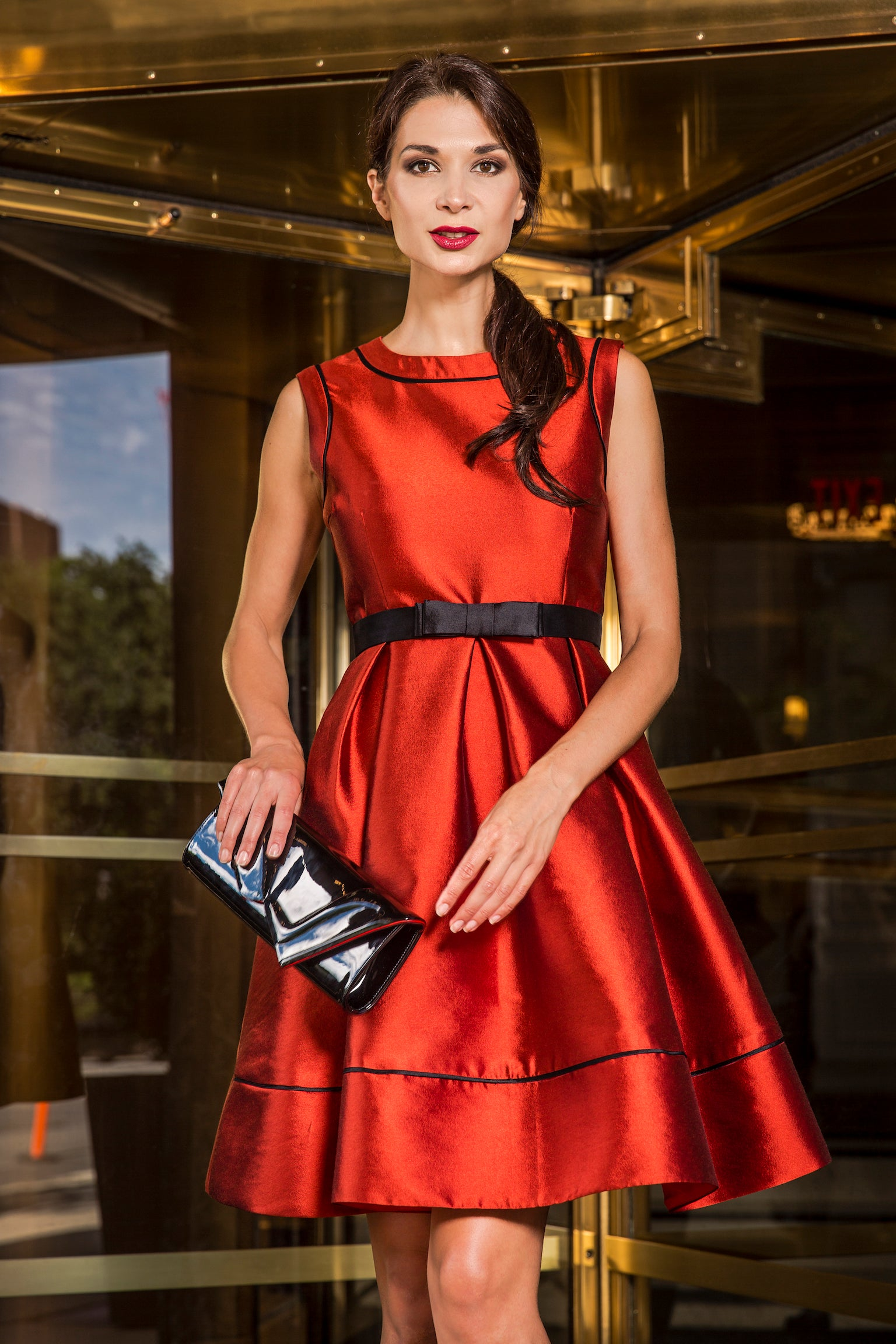 anna nieman designer dress Boston. Inspired by the style of iconic Audrey Hepburn, this silk/wool full skirt is accentuated with black trim and empire waist height belt with a classic bow.